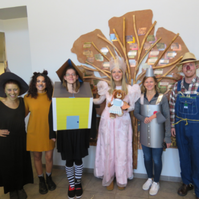 Group of employees dressed as Wizard of Oz characters